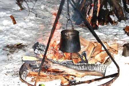 soup kettle: A pot of soup on the fire