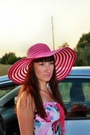 Sad girl near car Stock Photo
