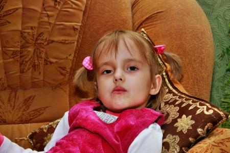 Four-year girl lying on the sofa Stock Photo - 15905603