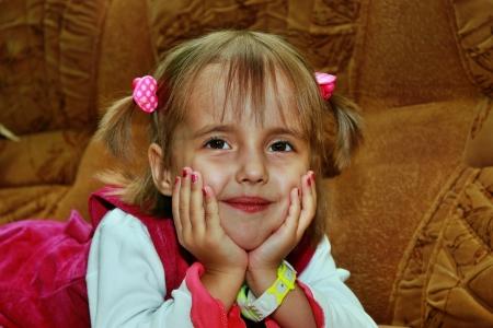 Little smiling girl lying on the sofa Stock Photo - 15905618