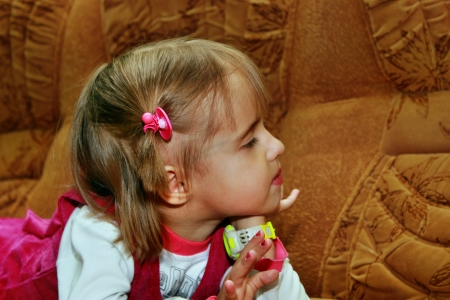 Little girl resting on the sofa, his head turned to the side Stock Photo - 15905633
