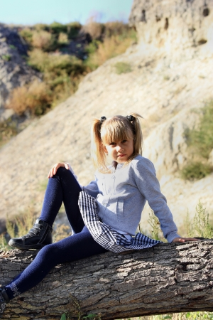 Girl resting in nature, sitting on a tree stump Stock Photo - 16036796