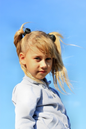 Portrait of blonde girl on a background of blue sky Stock Photo - 16036788