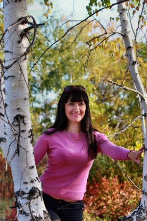 Beautiful girl in the autumn forest near birches photo