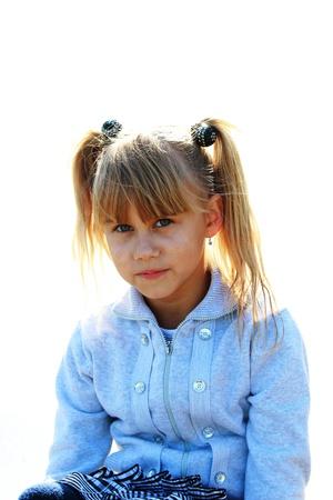 Portrait of a seus little girl in a blue jacket Stock Photo - 16249445