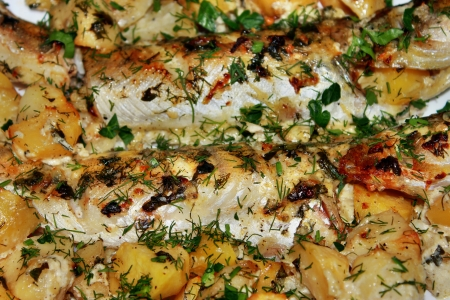 walleye: Walleye fish fried with potatoes on a plate close-up