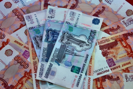 thousandth: Money background of five thousandth and thousandth Russian banknotes