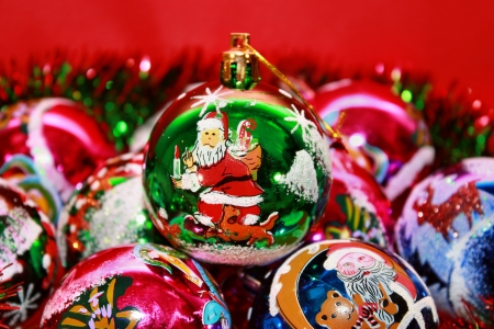 Christmas background of multi-colored balls and tinsel Stock Photo