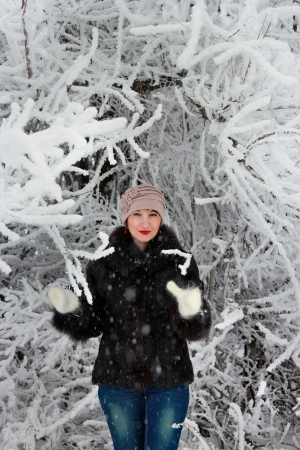 Girl in winter forest in a snowy tree Stock Photo
