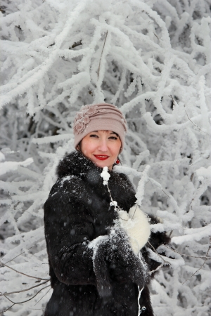 Girl among the snow-covered tree Stock Photo