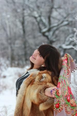 Happy girl enjoying a walk in the winter woods Stock Photo