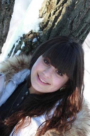 Winter portrait of smiling beautiful brunette Stock Photo - 18351277