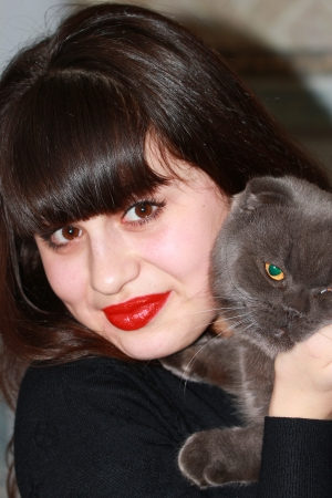british girl: Portrait of a young girl with a gray British cat in hands