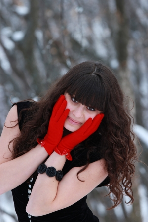 Portrait of beautiful brunette in red gloves photo