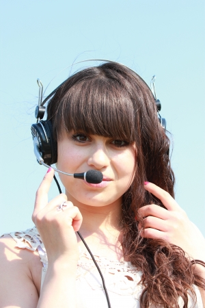 Portrait of a beautiful brunette in headphones with a headset