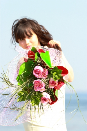 Bouquet of beautiful roses in female hands