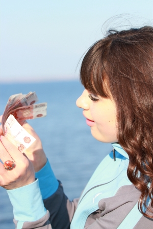 Young woman counting money Stock Photo