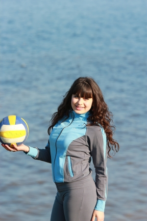 A beautiful young girl holding a volleyball Stock Photo