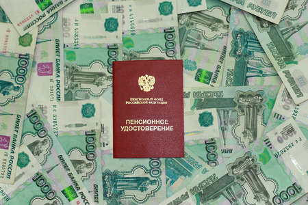 Pension certificate on the background of Russian money