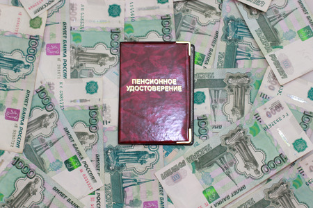 Pension certificate on background thousandths Russian banknotes Stock Photo