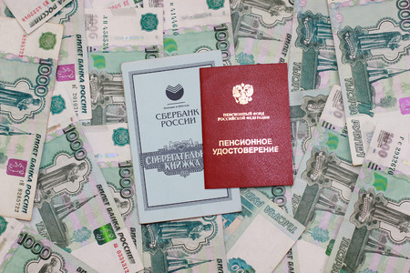 Background of the pension certificate and savings on knizhkai background thousandths bills Stock Photo
