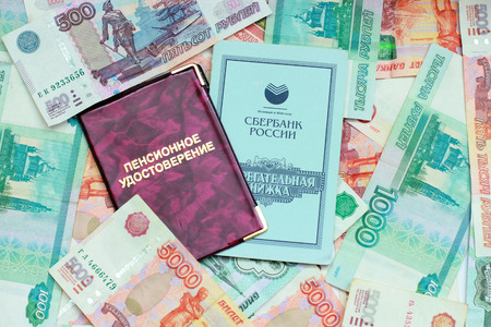 Documents on the background of the Russian money close up