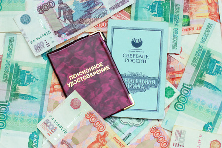 Documents on the background of the Russian money Stock Photo