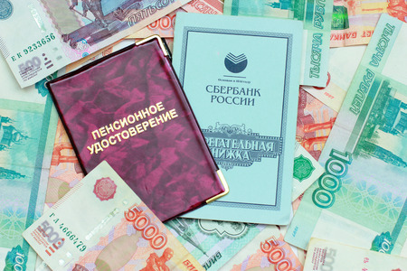 Close-up of Russian money, pension certificate and savings book
