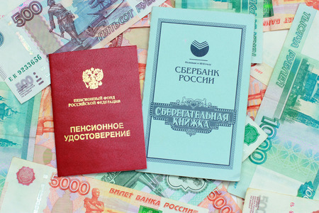 Russian money, pension certificate and savings book Stock Photo