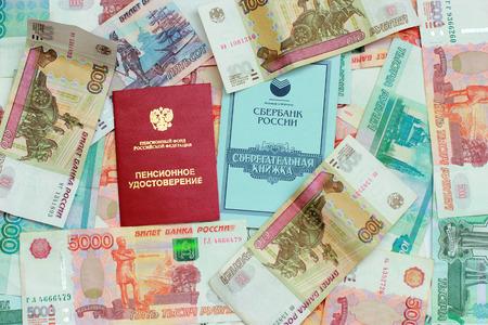 Russian money, pension certificate and savings book closeup