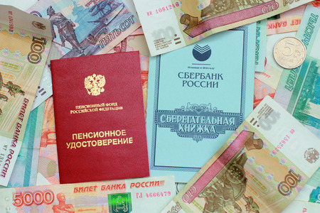 Pension certificate, passbook and money Stock Photo
