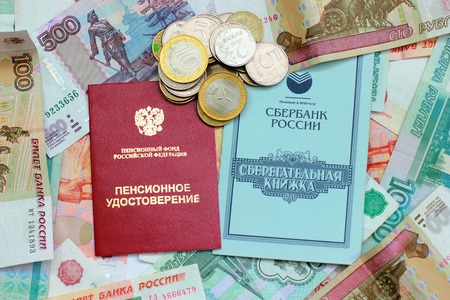 Pension certificate, passbook and money closeup