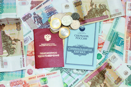 Passbook and pension certificate lie on the Russian money