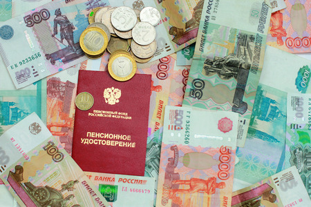 permits: Russian money and pension certificate closeup Stock Photo