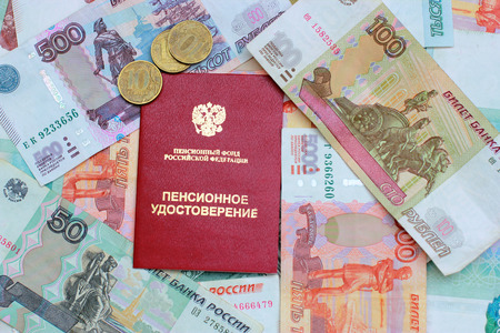Pension certificate and Russian money close up