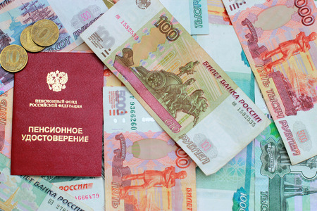 permits: Pension certificate and Russian money close up