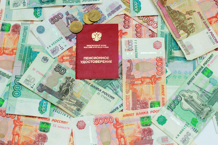 Pension certificate and Russian money Stock Photo