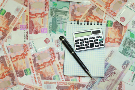 Money, pen, notepad and calculator