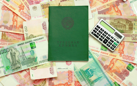 Work-book and calculator lying on the Russian money Stock Photo