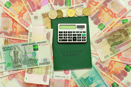 Calculator, employment history and Russian money Stock Photo