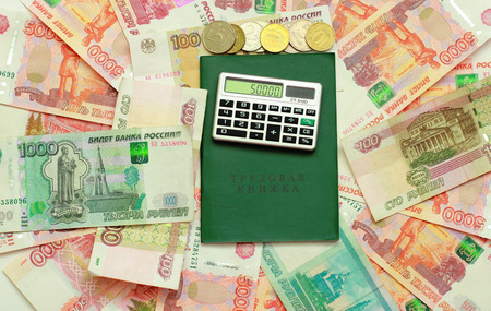 Calculator and employment history are on the Russian money Stock Photo