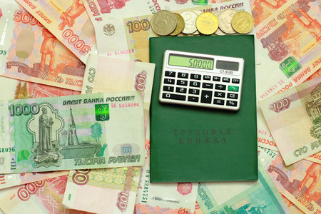 layoffs: Calculator and employment history are on the Russian money Stock Photo