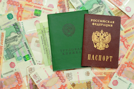 Employment records, passport and certificate of insurance on the Russian money Stock Photo