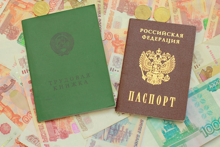 workbook: Work-book and a Russian passport lie on Russian money