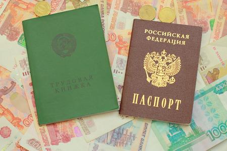 Work-book and a Russian passport lie on Russian money