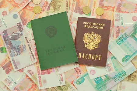 workbook: Work-book and a Russian passport lie on Russian money close up