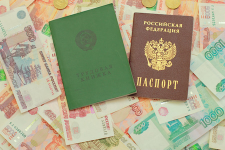 Work-book and a Russian passport for Russian money close up Stock Photo
