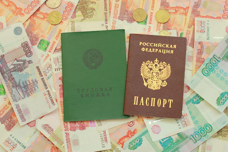 Russian passport and employment history are on the Russian money close up