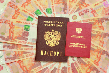 thousandth: Pension certificate and a Russian passport in the background of five thousandth money Stock Photo