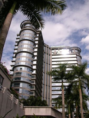 Building with palm trees in the foreground